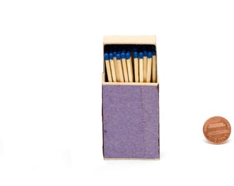 Match box, wooden matches with royal blue heads, striker from two sides