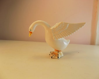SWAN Antique  very charming a charming little piece adds a nice touch to romantic home handpainted with great feathers and wings blue eyes