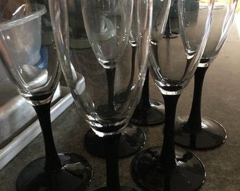 Set of six black stemed champagne glasses