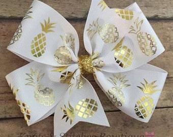 Gold pineapple pinwheel hairbow on alligator clip