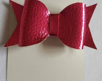 Small metallic bright pink PU leather look hair bow clip