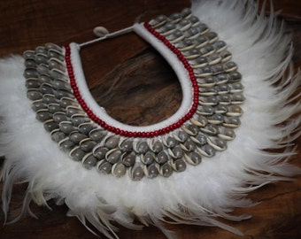 Papua Native Warrior necklace with white feathers and grey  shells.