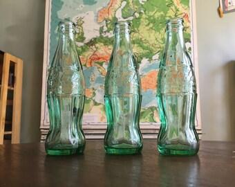 Set of 3 Vintage 1950s-60s Green 8oz Coca Cola Bottles - Misc Origins