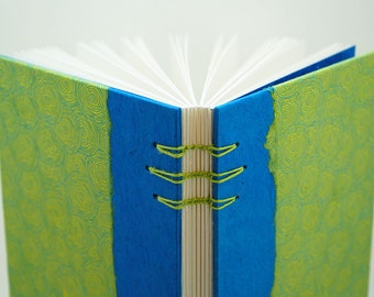 Coptic handmade notebook 10,5x21cm covered in lokta paper