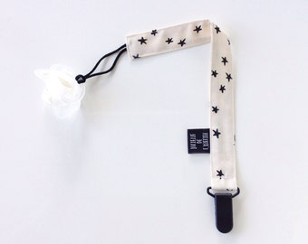 Off-white pacifier clip with star print