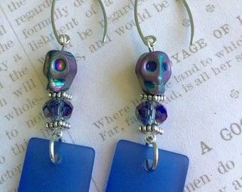 Blue sea glass and skull earrings