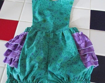 Green  and purple ruffled romper  size  18 months