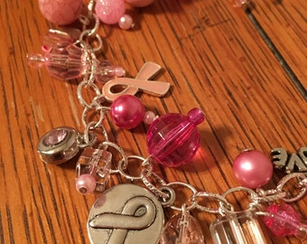 Pink Charm Bracelet with Breast Cancer Awareness Charms. 8.5 inches.