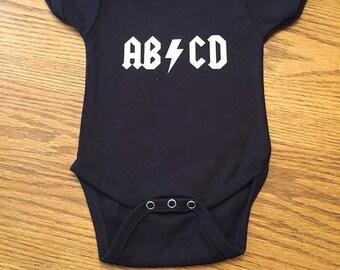 ABCD onesie
