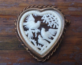 Antique heart shaped carved brooch