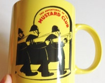 Lovely bright yellow ceramic china mug featuring the adventures of Colman Mustard Club perfect condition