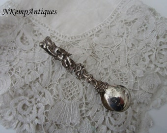 Antique silver sugar tongs with cherub real silver for the collector