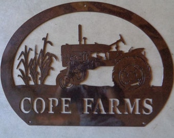 Personalized, metal sign with  corn stalks and old  tractor