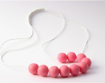 Pink Round Resin Bead Necklace on White Waxed Cotton