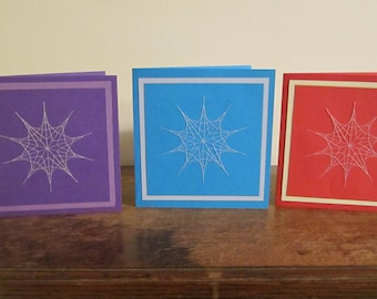 Snow stitch cards (a) - Handstitched snowflakes on handmade cards