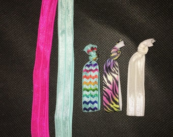 Elastic head bands and hair ties