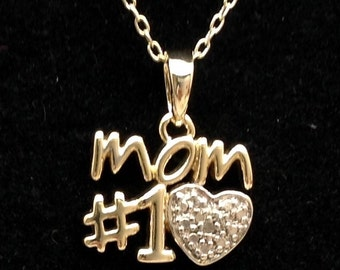 "Sterling silver ""#1 Mom"" pendant."