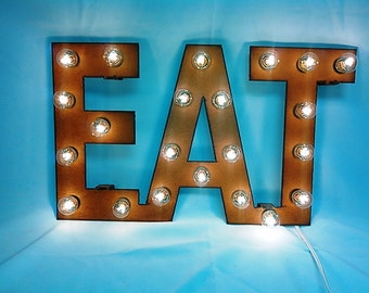 Eat Marquee Lighted Sign Made out of Rusted metal