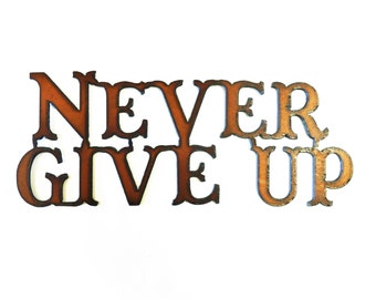 Never Give Up sign made out of rusted rustic recycled rusty metal
