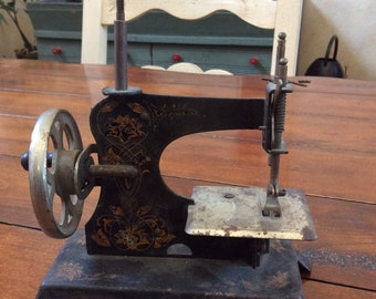 Miniature toy sewing machine - made in Germany