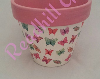 Hand Decoupaged  plant pot decorated with bright multi coloured butterflies