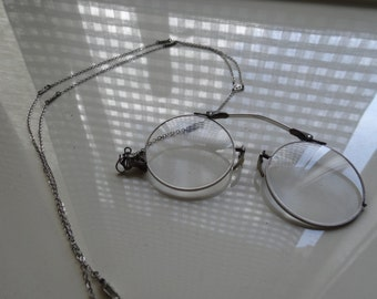 Antique custom made magnifying glasses with a case.