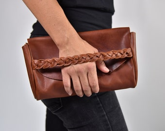 Leather envelope clutch. Cognac brown vegetable tanned leather clutch, braid closure, four card & two passport pockets by halfmoon