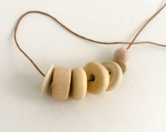 "Mixed media necklace. ""Study in Neutrals"""
