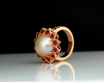 Mabe pearl, with rubies set in 14k rose gold.