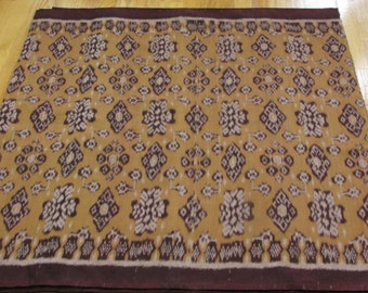 Hand woven yellow-beige cotton Ikat fabric by the yard