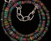 16'' AAA smooth roundel shape multi wello fire Ethiopian black opal beads strands good quality wholesale price. 0003
