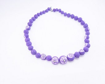 Purple necklace with round beads polymer clay flower