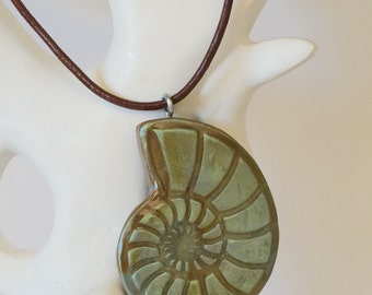 Polymer clay ammonite pendant