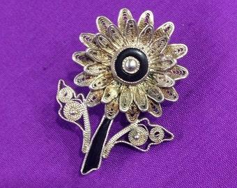 Fun filligree flower brooch