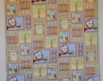 Owl patterned baby quilt