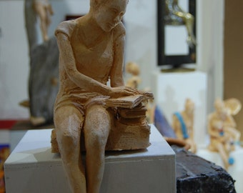 Sitting  girl reading the book - Red clay - 12x16x35cm