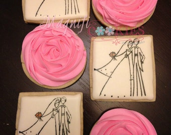 Bride & groom wedding favor decorated cookies with flowers