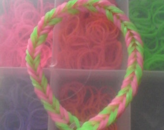 Pink and green rubber band bracelet
