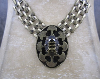 Exquisitely designed brassy bronze metal necklace with smoky topaz pendant