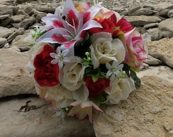 Rose, Ranunculus, and Stargazer Lily bouquet with matching boutonnière