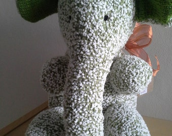 Green and white snowball wool elephant with ribbon.