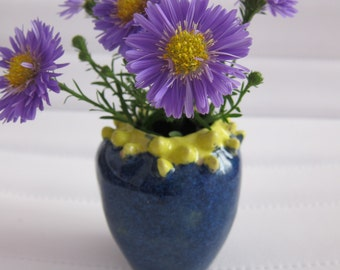 Small blue and yellow vase