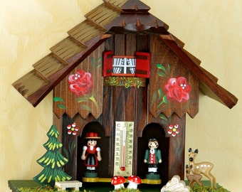 Germany Black Forest-weather houses- Original Schwarzwald- Wetterhaus 18 cm - Mann/Frau- Holzfiguren
