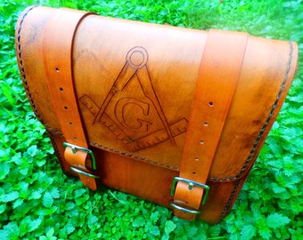 Handmade leather motorcycle bag in antique saddle tan