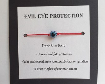 Make a Wish dark blue evil eye bracelet on red cord