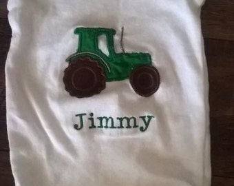 Personalized john deere tractor appliqued onesie. Made to order
