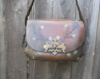 Distressed Vintage Tooled Leather Handbag with braided shoulder strap and fancy lock