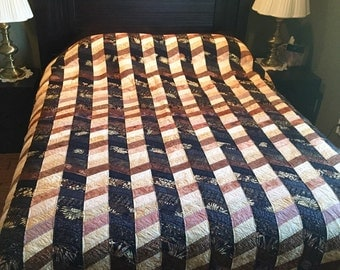 Brown and black patterened quilt
