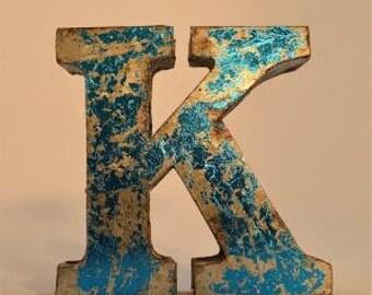 A fantastic vintage style metal 3D blue letter K