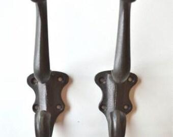 A pair of Art Nouveau cast iron coat hooks AL5